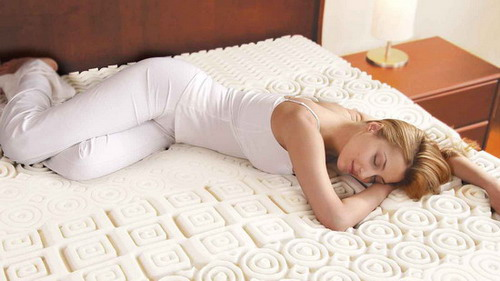 Pretty woman sleeping on soft mattress