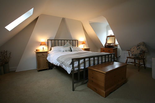 Renovating attic from storage to bedroom for Attic bedroom decoration